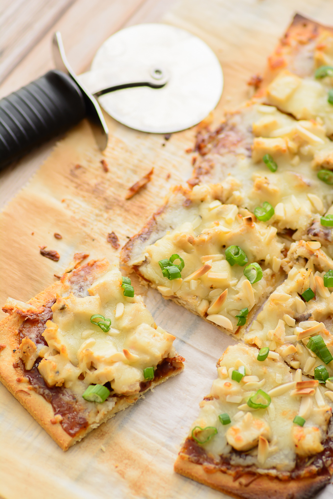Gluten Free Spicy Chicken Flatbread. Great gluten free recipe for lunch or dinner. Made with an almond flour crust and simple ingredients. Could be made into a paleo recipe if you don't use the cheese. Yum!