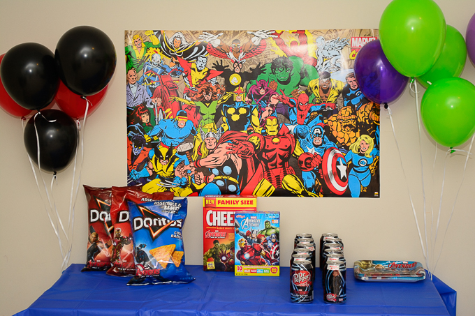 Avengers Party Table with Doritos, Cheez-its, Dr. Pepper and Kellog's Fruit Snacks.