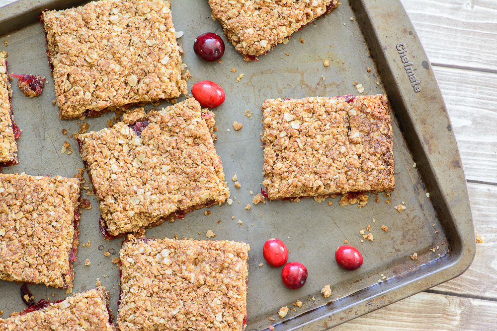 Gluten Free Cranberry Oat Bars. Yummy fall recipe made with fresh cranberries, oats and almond flour. Delicious!