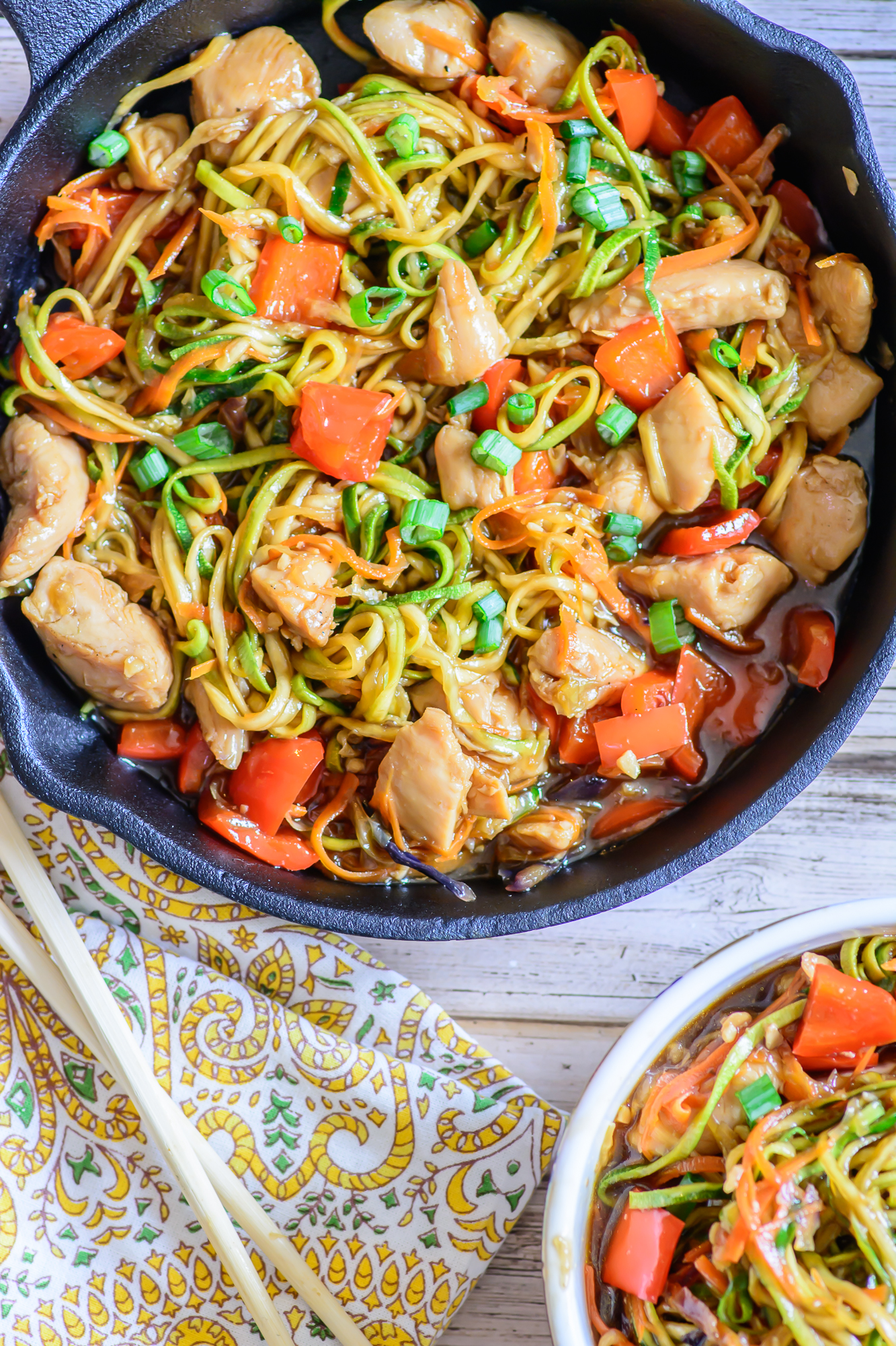 This amazing one skillet zoodle recipe is healthy, low carb, paleo and gluten free and is a perfect healthy meal that is a little sweet and a little spicy. You won't believe how good it tastes!
