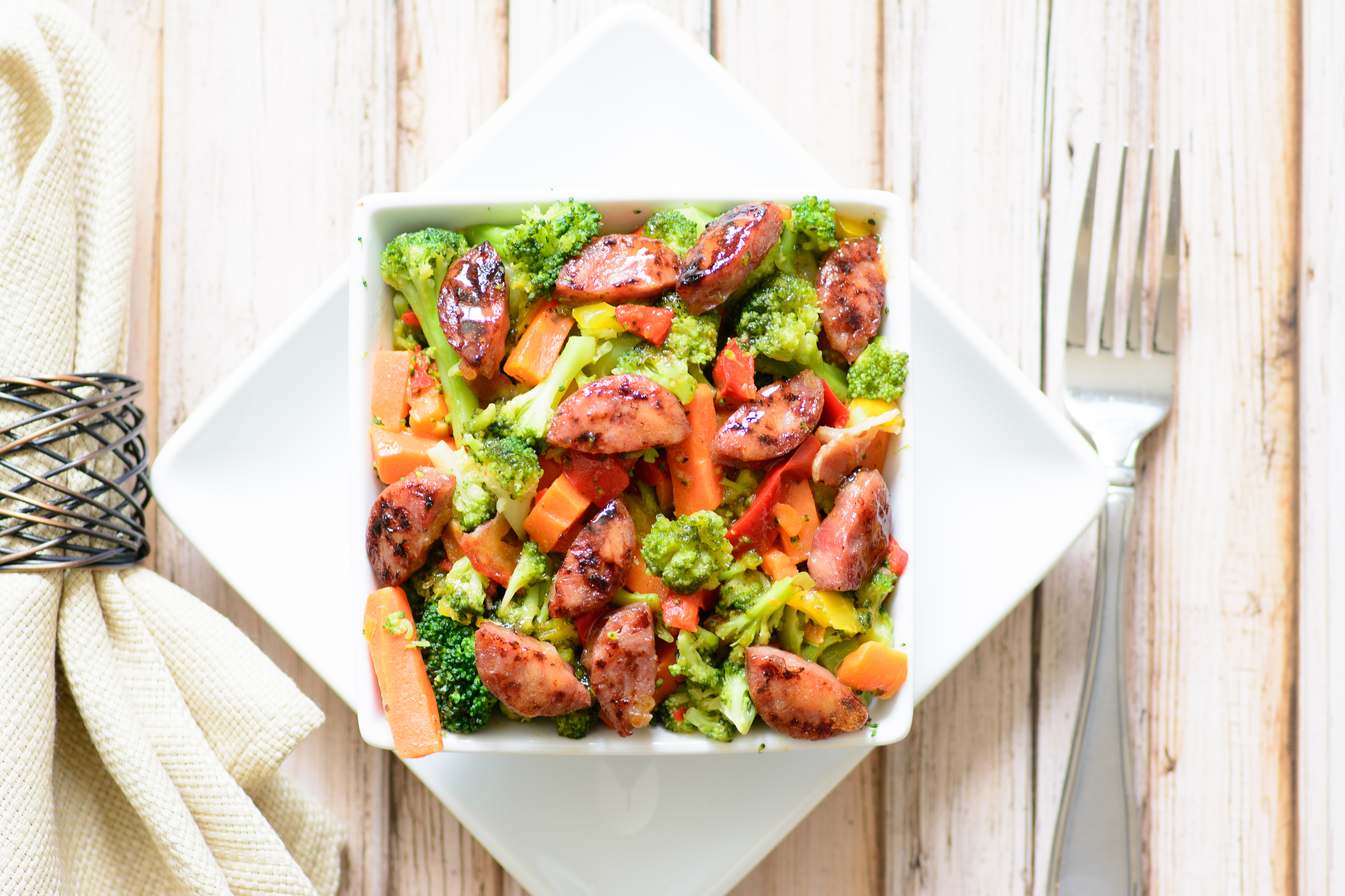 Sausage & Steamed Veggies with Pineapple Sriracha Sauce. This whole food recipe gluten free and paleo, making it a delicious alternative to processed foods. You won't believe how good this tastes.