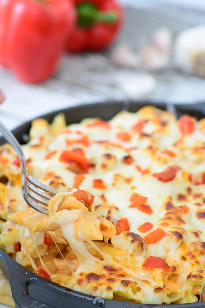 Roasted Red Pepper Chicken Alfredo Casserole. Every bite is a flavor explosion. Everybody in the family will love this delectable dish!