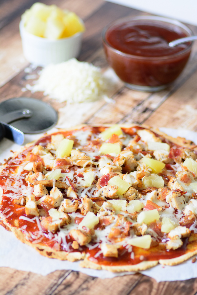 Delicious, good for you gluten free BBQ chicken flatbread. Indulge your tastebuds with bacon, bbq sauce, chicken and pineapple! So easy to make and tastes like summer!