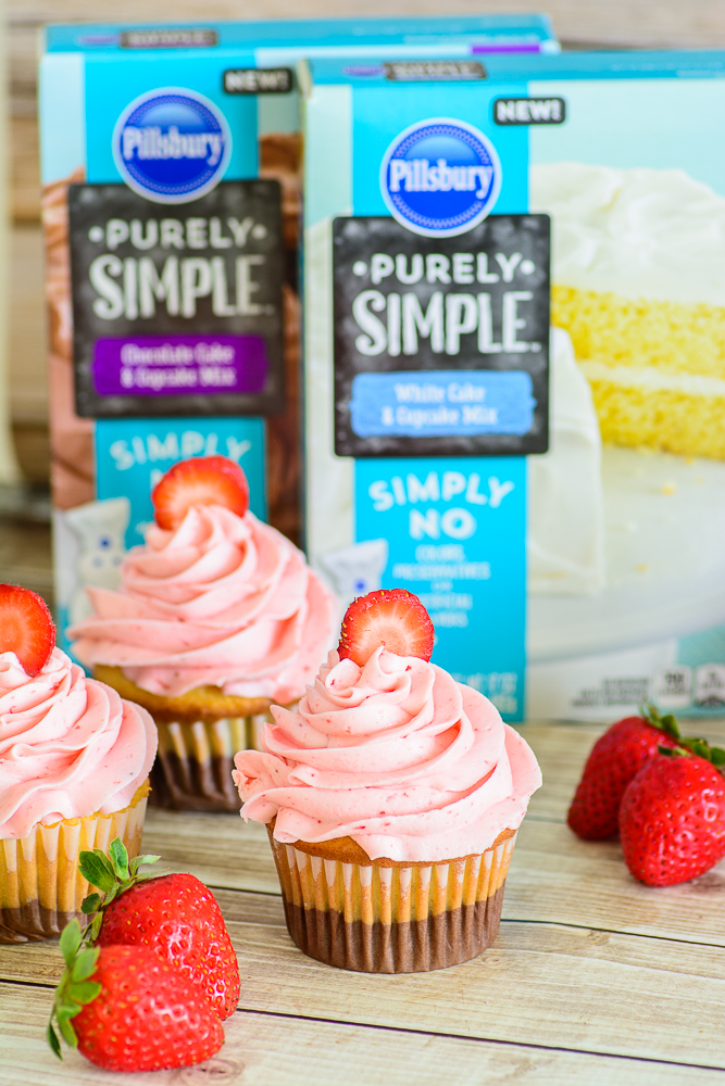 Neopalitan Cupcakes. Made with all natural ingredients and topped with a delicious real strawberry buttercream. Fun cupcake recipe!