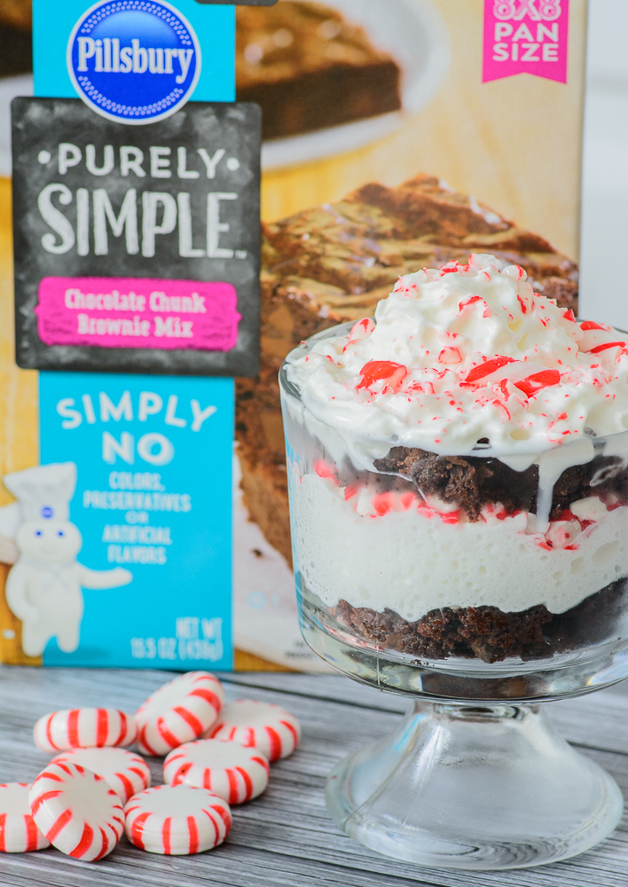Decadent peppermint brownies topped with whipped cream and crushed candy canes. This peppermint brownie trifle is to die for! YUM!!