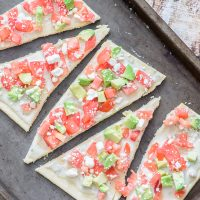 This skinny gluten free flatbread is packed with healthy fats and protein that will fill you up without filling you out! One of the easiest gluten free recipes out there.