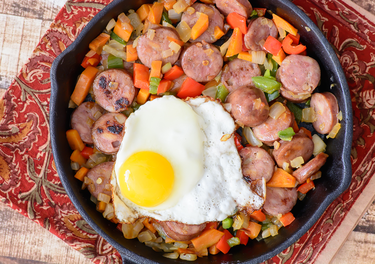 Aidells sausage, peppers, sweet potatoes and onions combine in an easy to make, healthy and delicious meal that takes just 15 minutes. Have to try this yummy sausage hash.