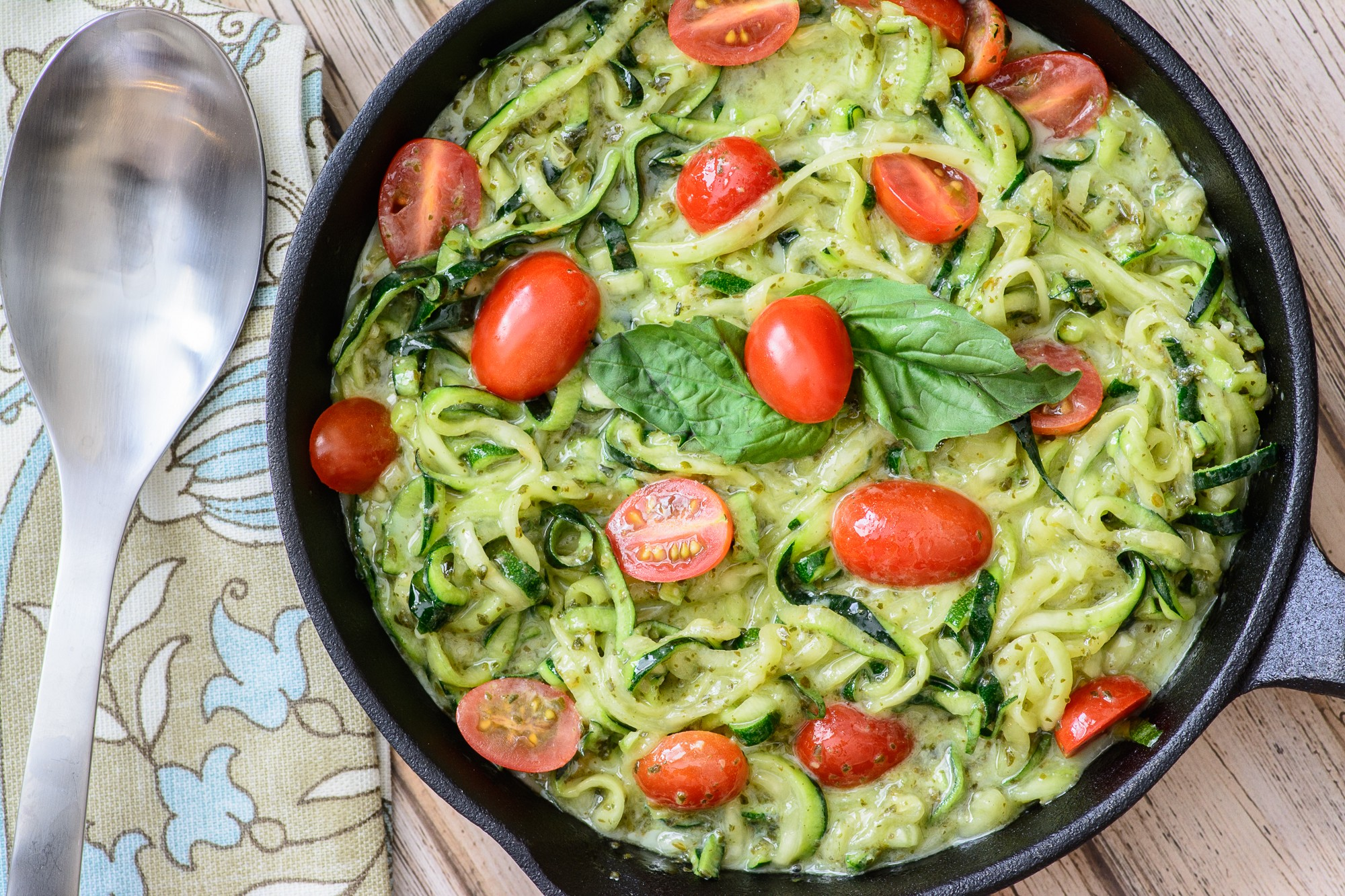 Creamy pesto with fresh zucchini noodles. These are a healthy, low carb, paleo and gluten free alternative to regular noodles. You won't even miss the pasta! Arguably the best zoodle recipe out there.