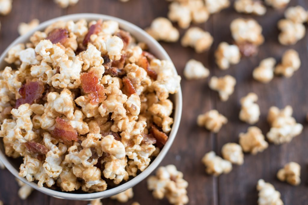 Maple Bacon Popcorn. Sweet maple syrup and savory bacon combine in this heavenly popcorn recipe that is sure to make your taste buds shout for joy!